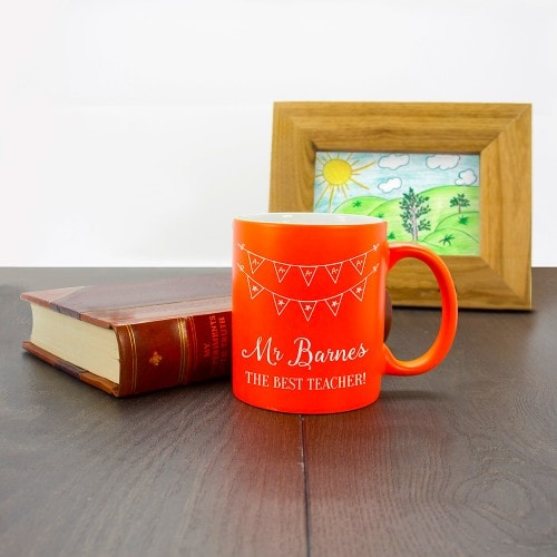 The best teacher orange personalised mug with bunting design