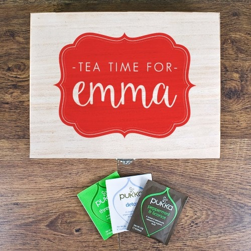 personalised red teabox with name on the front