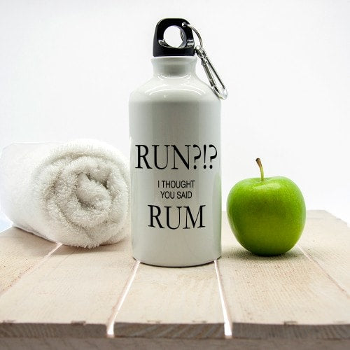 white waterbottle with humerous saying next to apple and towel