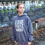 Thug Yoga Love People Harder Hooded Sweatshirt out in the world