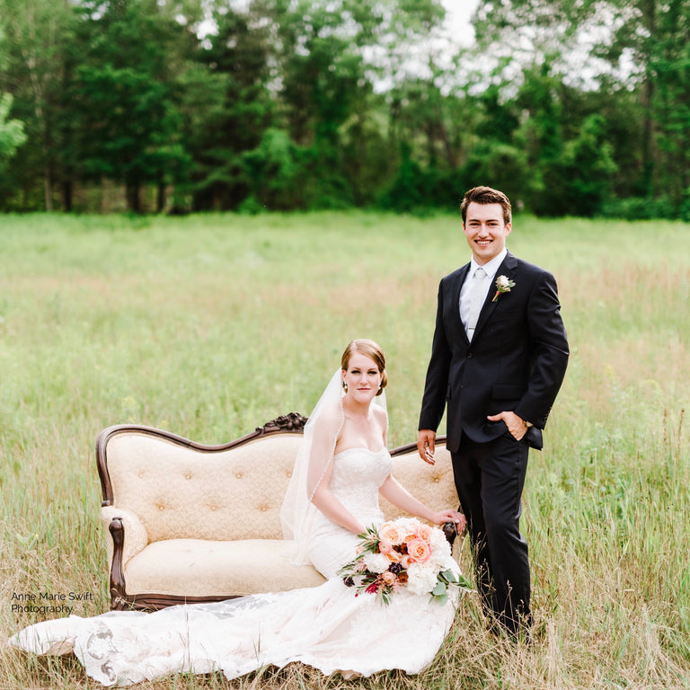 Bride and groom with bridal bouquet.