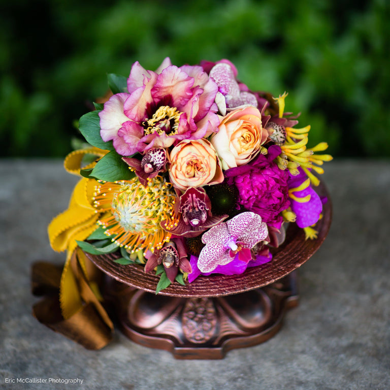 wedding bouquet in gold, copper, and fuschia