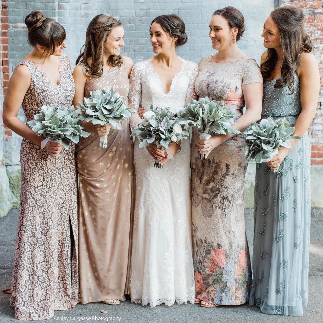 Silver grey bridal party bouquets of dusty miller and silver brunia.