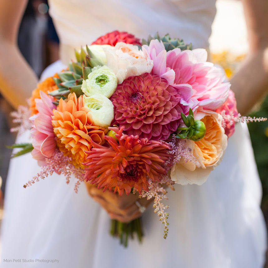 Bride's bouquet with dahlias, ranunculus, and astilbe.