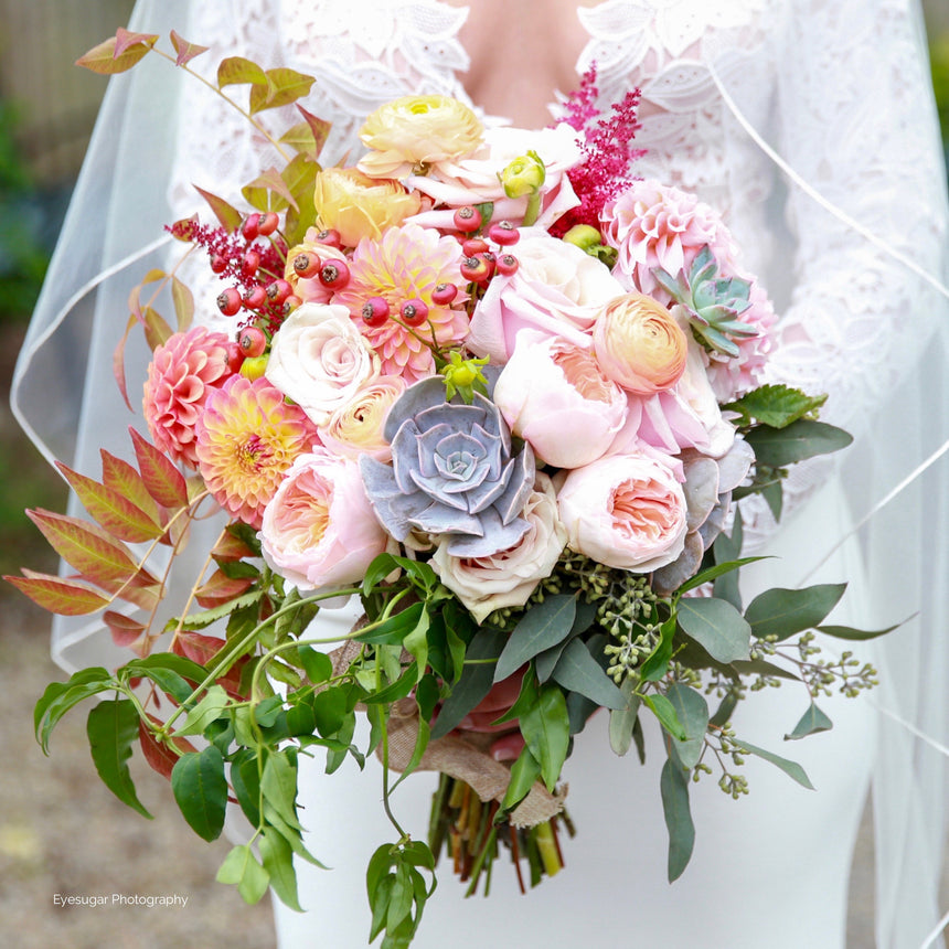 Fall bridal bouquet in blush, copper, and sage green with succulents and garden roses.