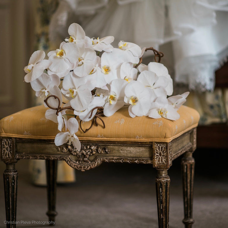 Bridal bouquet of white phalaenopsis orchids.