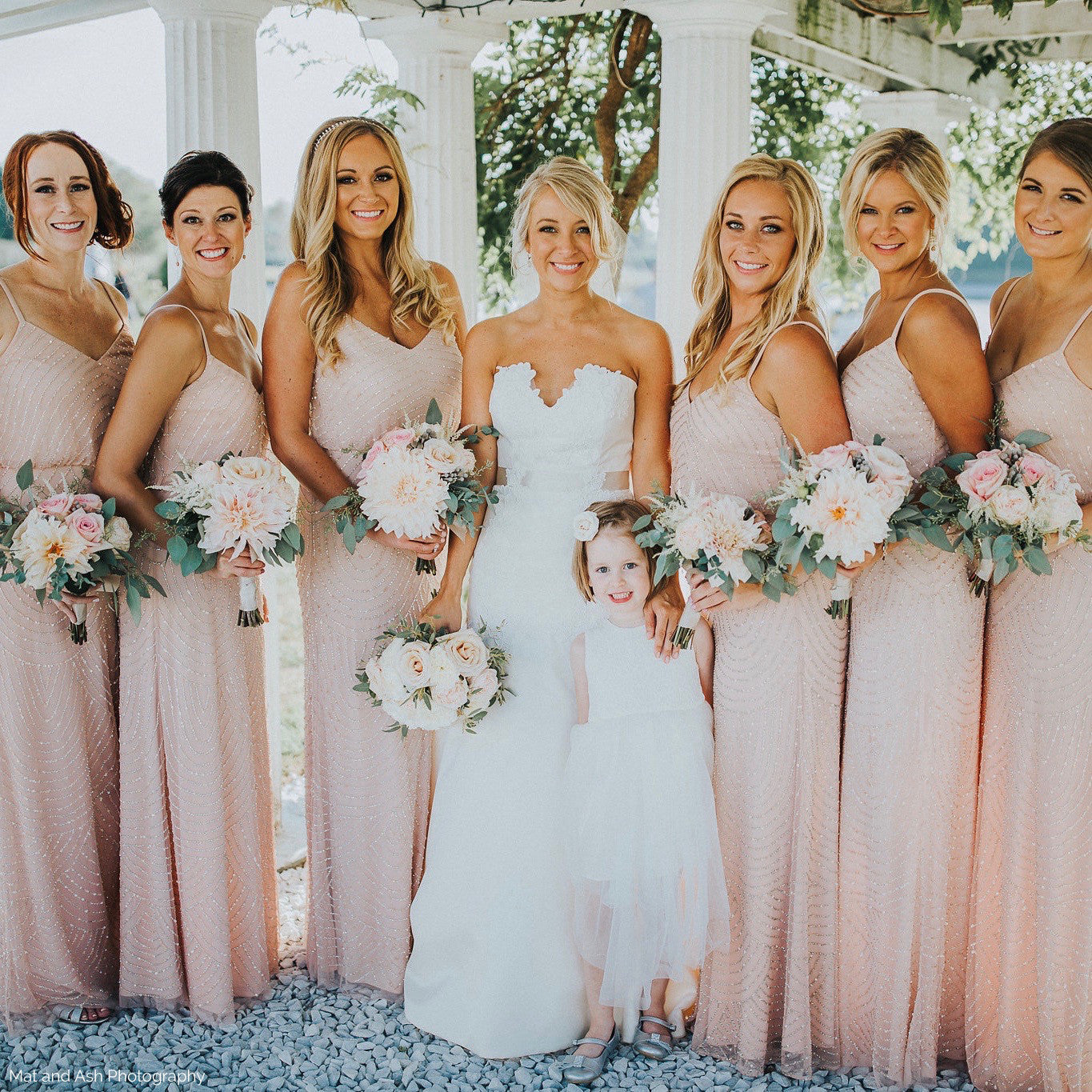 Bridal party bouquets in blush and sage green with cafe au lait dahlias.