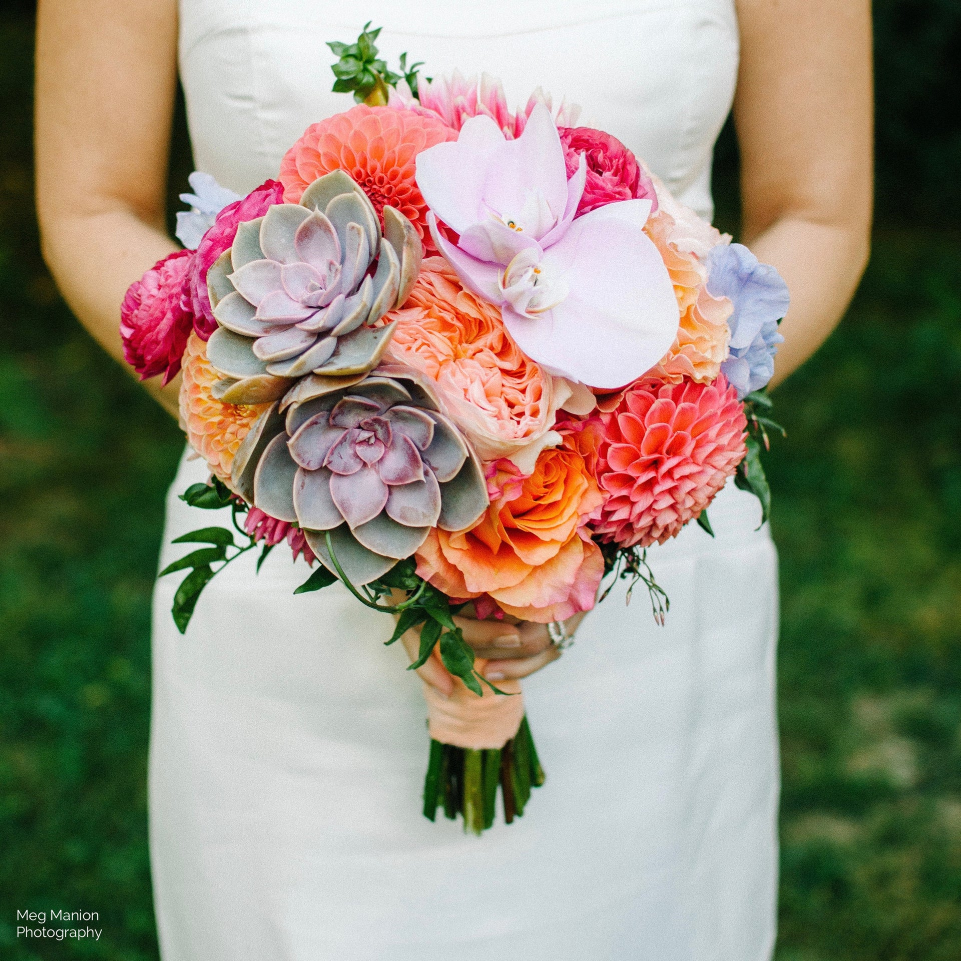 Bride's bouquet with dahlias, succulents, and orchids.