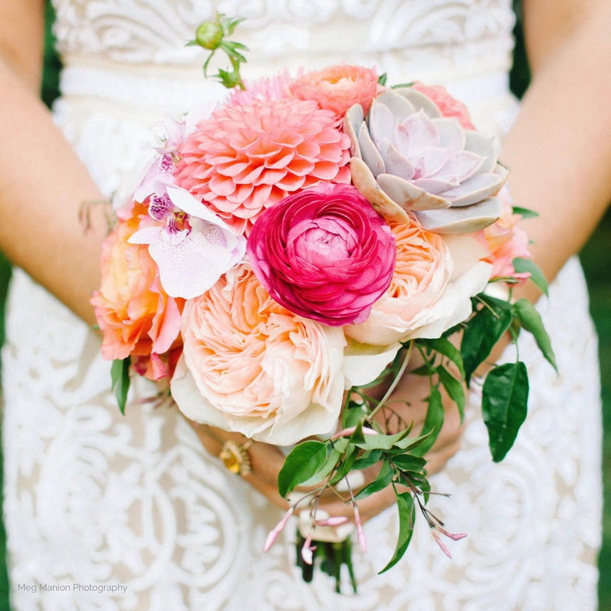 Bridesmaid bouquet with ranunculus, dahlias, and succulents.