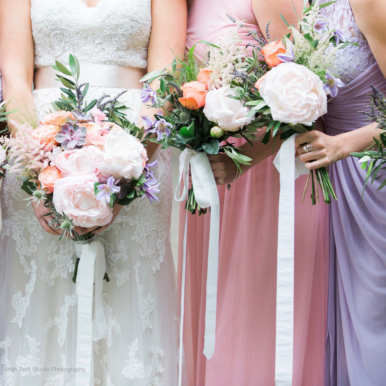 Bridesmaid's bouquets with peonies and roses.