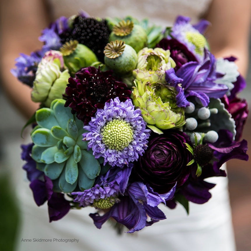 Bridal bouquet in lavender, plum, and sage green.
