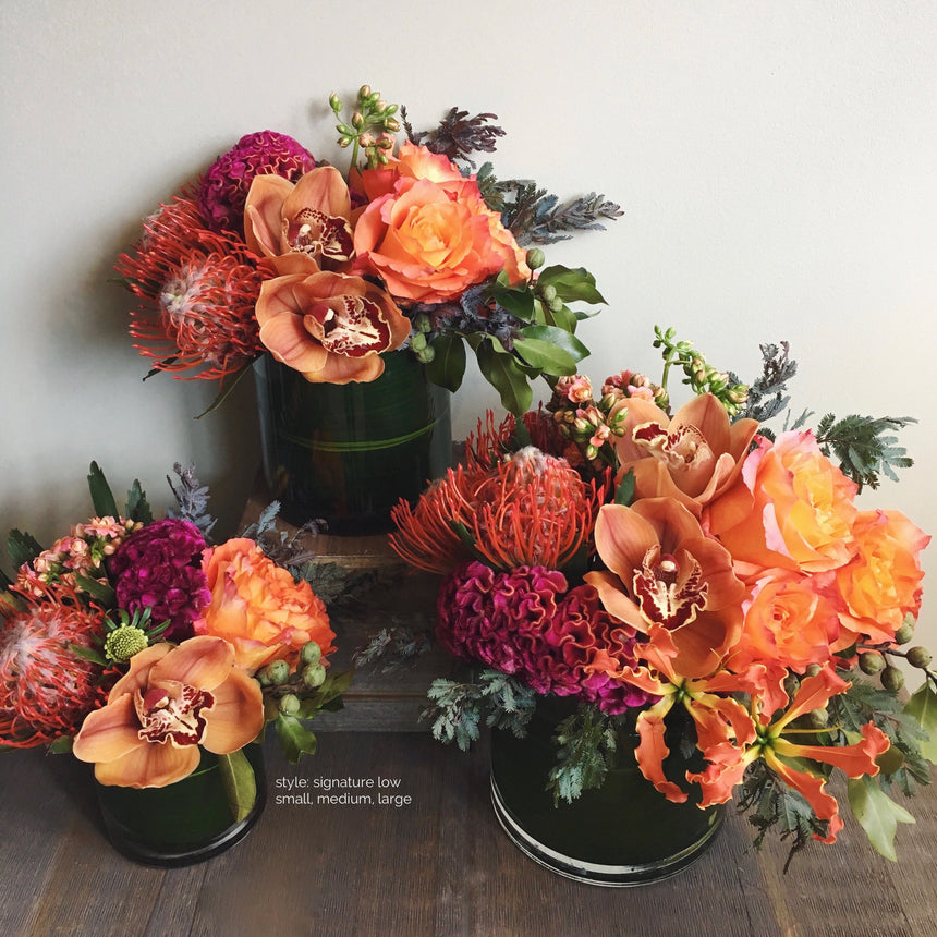 Small, medium, and large sized autumnal low arrangements.