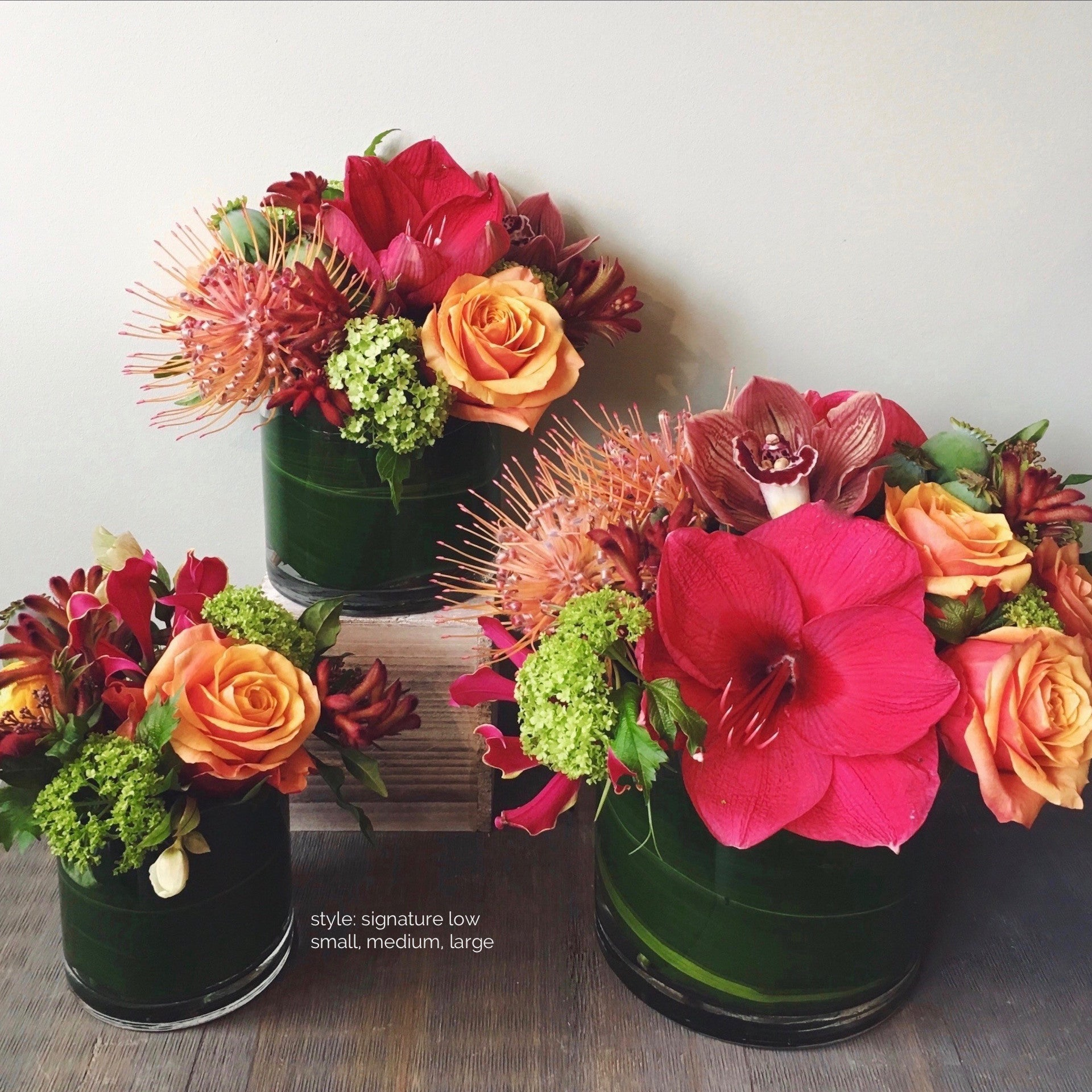 Small, medium, and large sized low arrangements available for delivery.