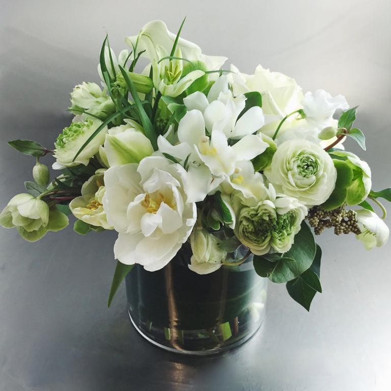 Arrangement in white and green with tulips, frittilaria, and ranunculus.