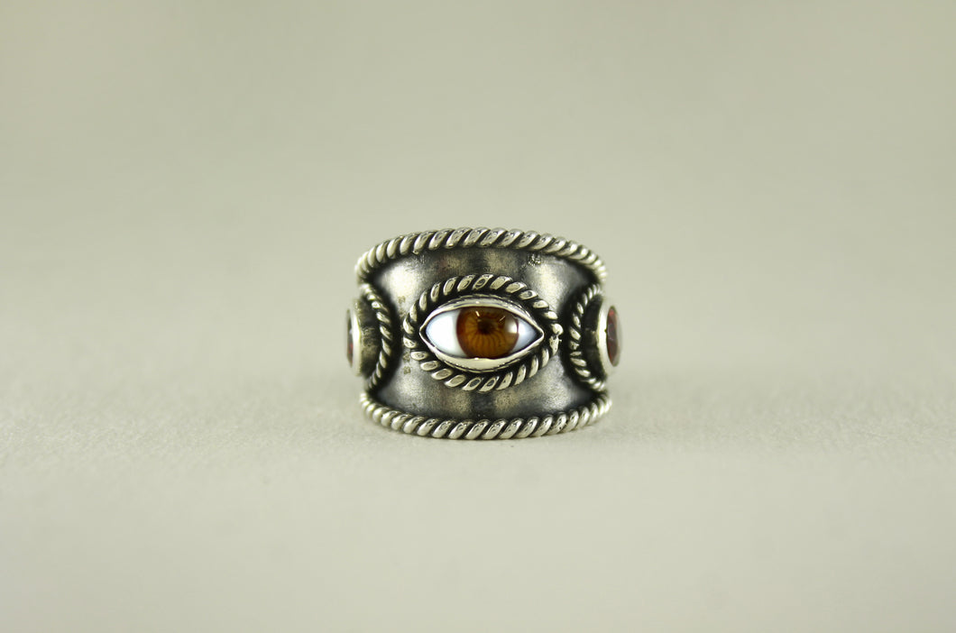 SILVER EYE RING WITH GARNETS