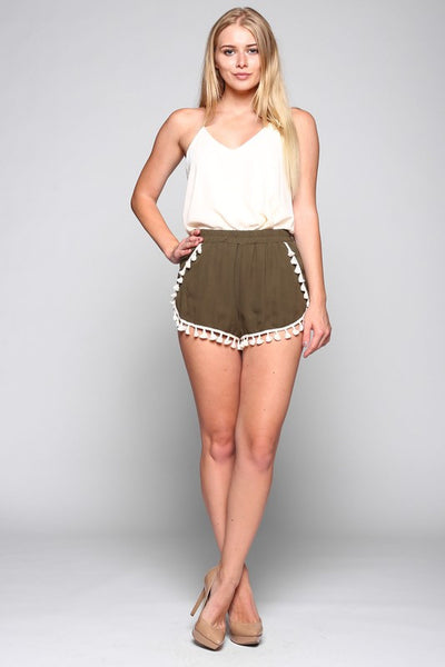 Get festival ready in Bohemian dream shorts in olive! These tassel trim shorts, with elastic waist slip right on with ease and pair perfectly with your favorite cami or peasant top.