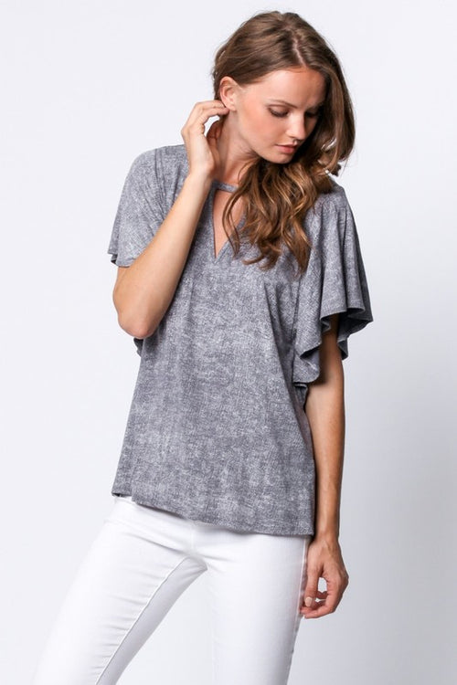 Easy stretch knit top, with relaxed fit. Features a flutter sleeve, and keyhole.