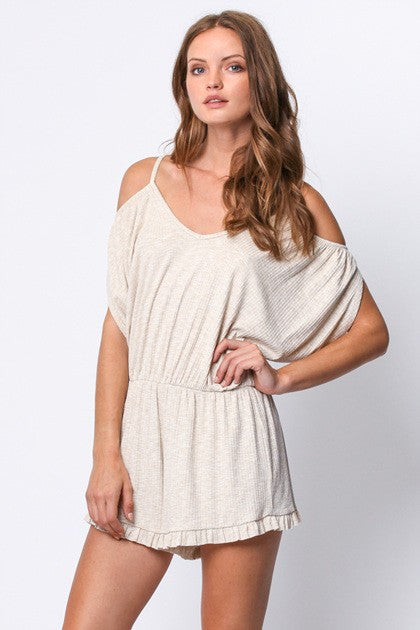 Slip into the comfy chic of the Venice Beach Romper. This fun, flirty romper features a cold shoulder and criss cross back. Soft, ribbed knit jersey features a relaxed fit and ruffle trim shorts.