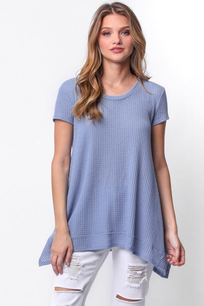Let your self get cozy in the Lucy Waffle Knit Top in Dusty Blue. Easy fit short sleeve top with shark bite hem and keyhole tie.