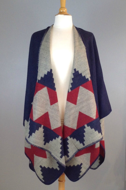 navy and red reversible poncho wrap features bold graphic print and blanket stitch detail