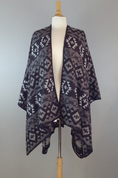 Soft and cozy poncho wrap in colorful Aztec print. black and grey