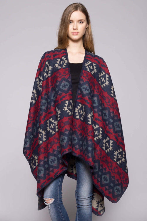 Soft and cozy poncho wrap in colorful Aztec print. red with navy