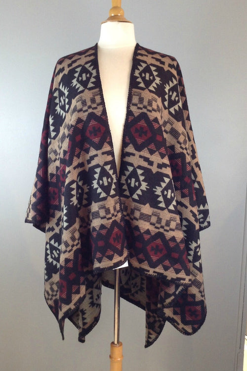Soft and cozy poncho wrap in colorful Aztec print. Brown with black