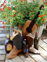 cowboy boot with guitar bottle carrier