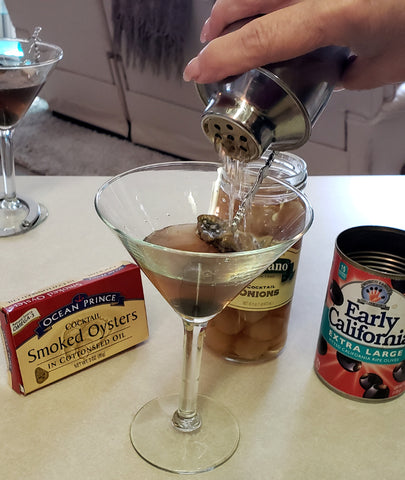 Shake mixture and pour into Martini Glass with Garnish
