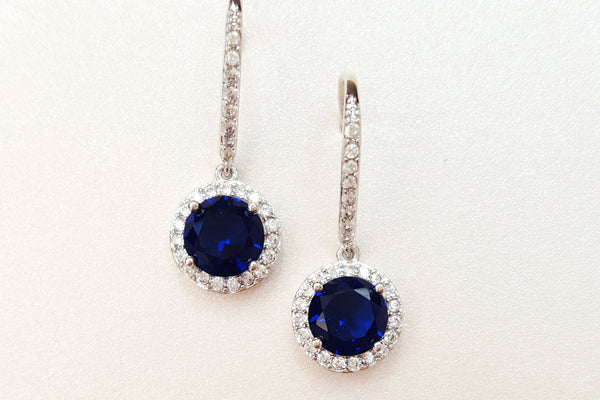 Sapphire earrings enticing candles for Man made sapphire jewelry