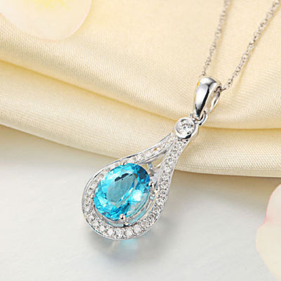 14K White Gold 2.5 Ct Oval Swiss Blue Topaz Pendant Necklace 0.26 Ct Diamond - diamondiiz.com