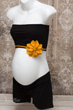 Merigold coloured accent flower to dress up a maternity bump for photos