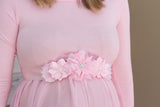Pink maternity sash belt to accent a baby bump for gender reveal photos