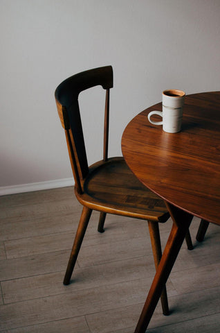 A Wooden Dining Chair With Seat Scoop