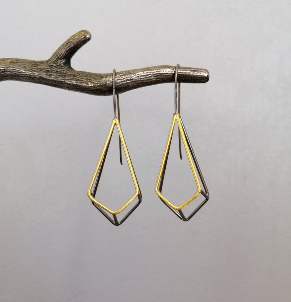 Polyhedron black rhodium and gold earrings