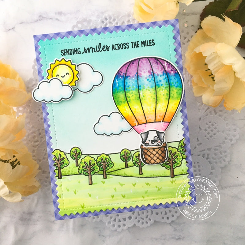 "Sunny Studio ""Sending Smiles Across The Miles"" Dog in Rainbow Hot Air Balloon Flying over Trees with Sunshine and Clouds Card (using Balloon Rides 4x6 Clear Stamps)"