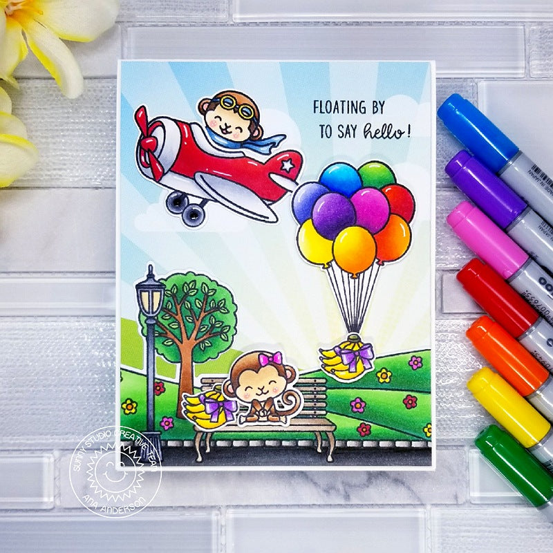 Sunny Studio Stamps Monkey Flying in Airplane with Rainbow Balloons at the Park Handmade Card (using sunburst with clouds patterned Paper from Spring Fling 6x6 Pad)