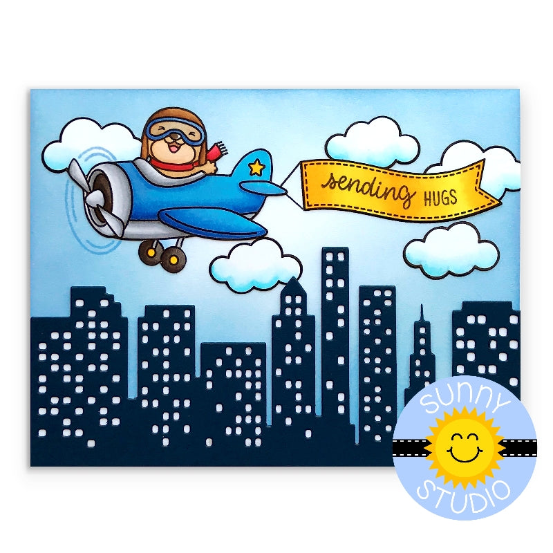 Sunny Studio Stamps Plane Awesome Sending Hugs blue airplane flying over city with clouds and yellow banner handmade Card
