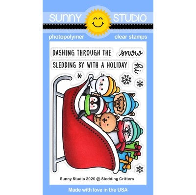Sunny Studio Stamps Sledding Critters 3x4 Clear Photopolymer Stamp Set featuring seal, penguin, alpaca, cat and sheep dog with gifts and snowflakes in sleigh