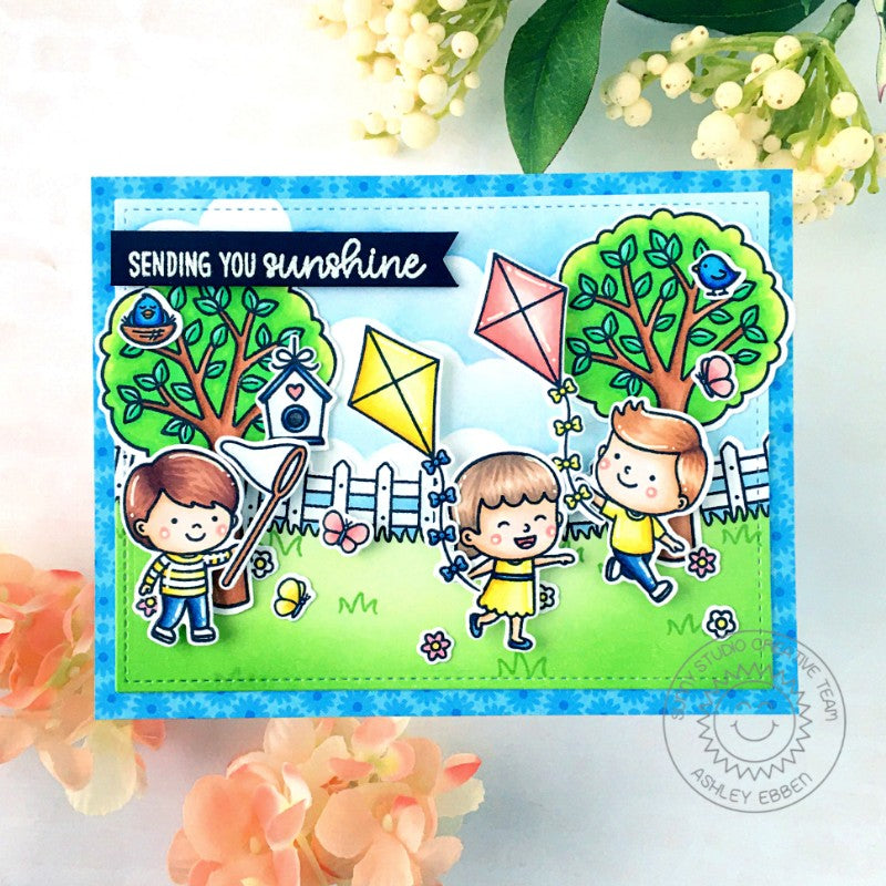Sunny Studio Stamps Spring Themed Flying Kites with Trees, Fence & Birdhouses Handmade Card with custom sentiment greeting by Ashley Ebben (using Spring Scenes Background Border Stamps)