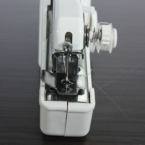 Image of Hand Held Sewing Machine