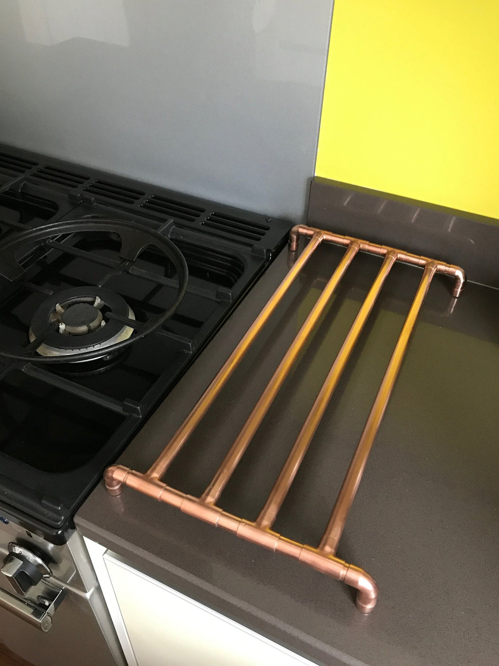 Copper Trivet on a Granite Kitchen Worktop