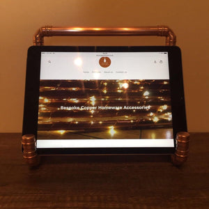 Copper Pipe Stand Holding an iPad