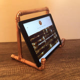 A side view of the Copper Pipe iPad Stand