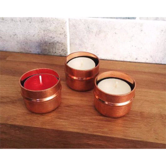 Three Copper Tea Light Holders with Candles