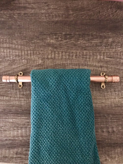 Handcrafted Copper Towel Rail with a Dark Green Towel Hanging