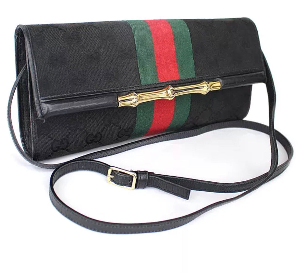 GUCCI SUPREME CLUTCH BAG WITH WEB DETAIL