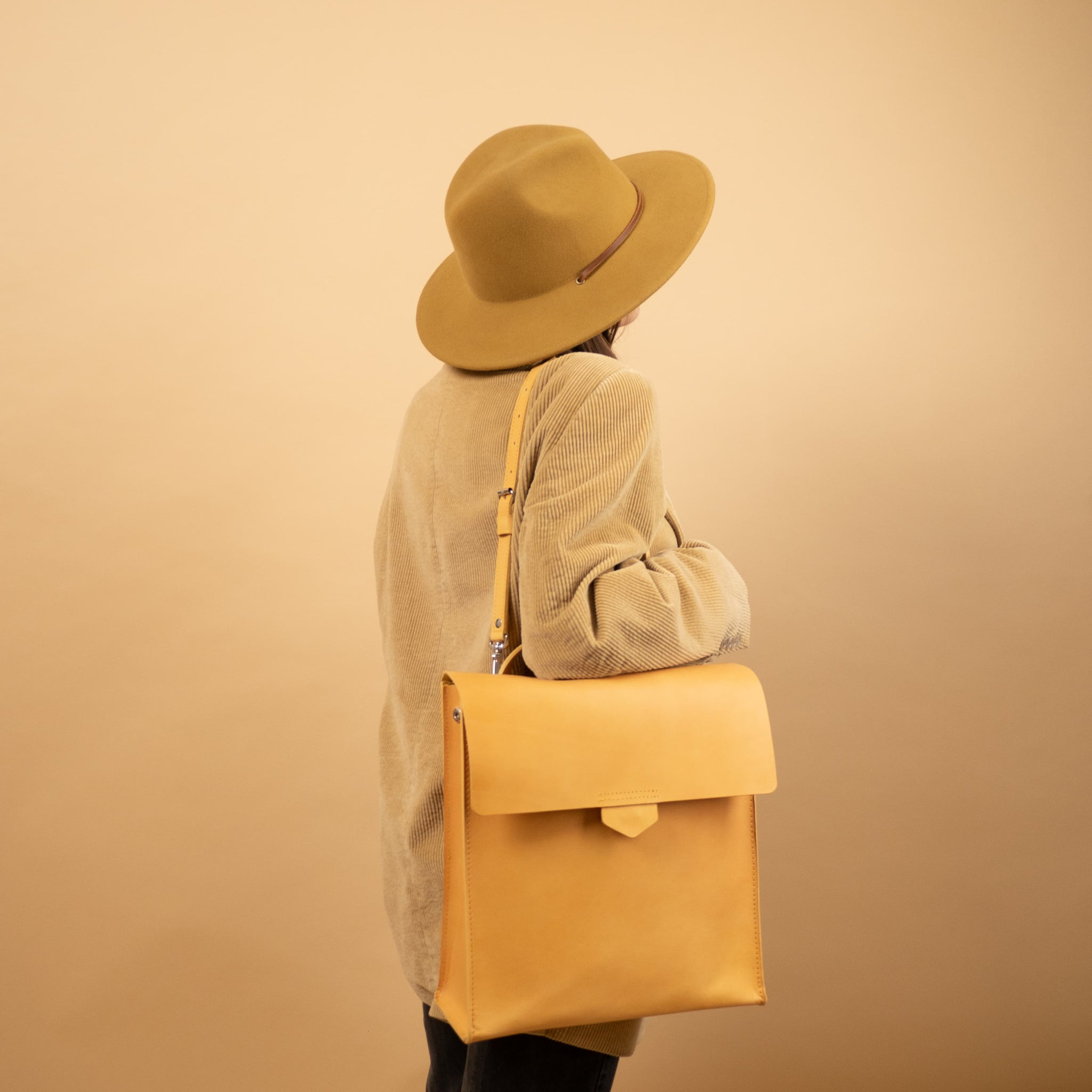 yellow leather backpack purse