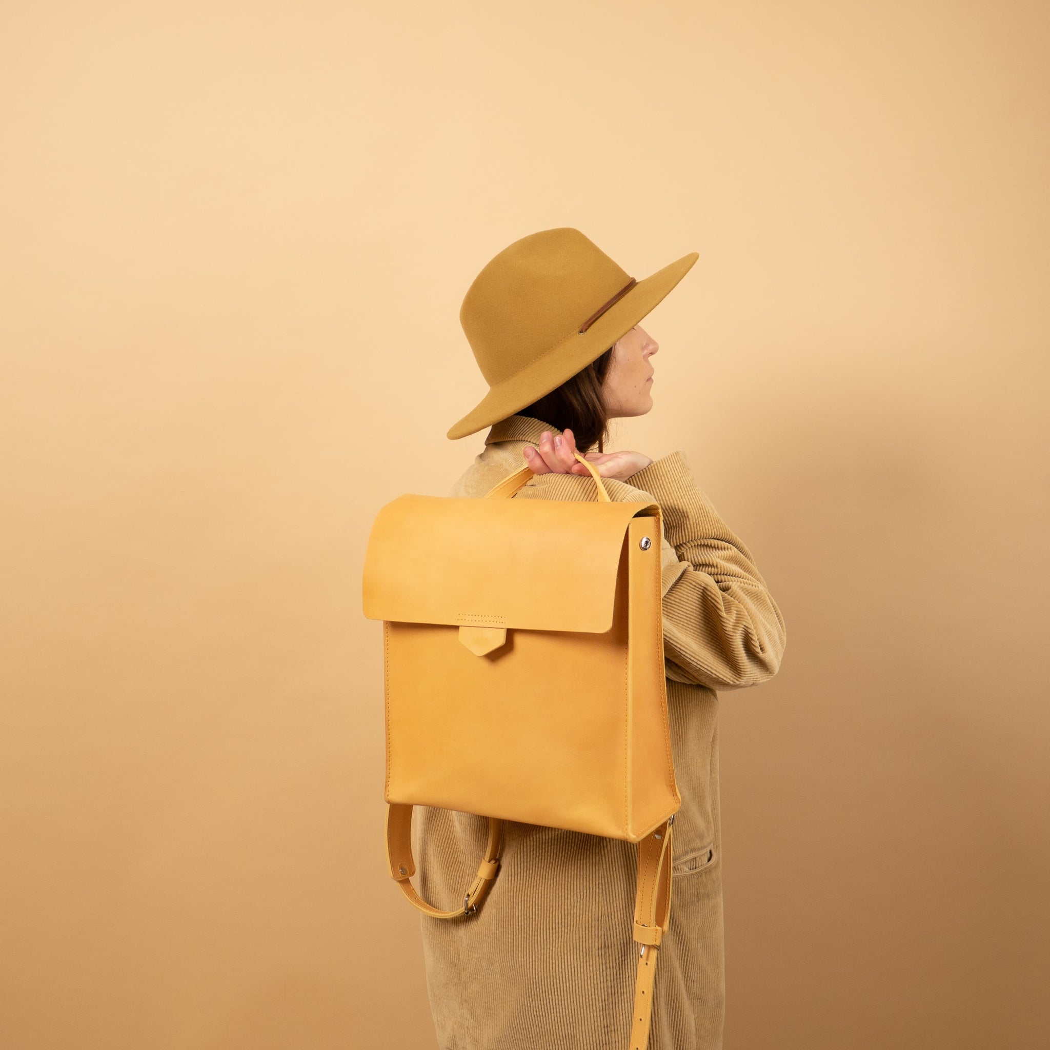 yellow leather rucksack