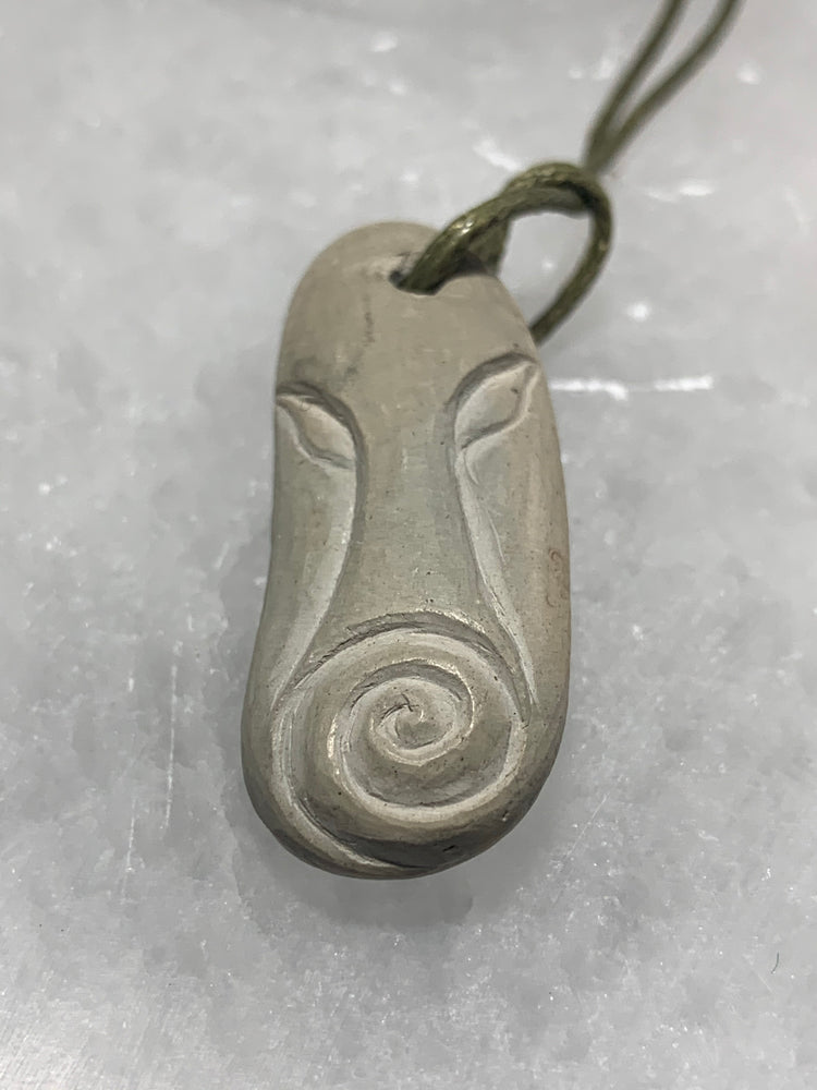 Hand Carved Stone Pendant with Plant
